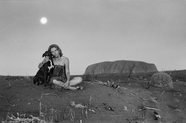 Robyn Davidson is pictured with her dog Diggity in the Australian Outback in 1977. PHOTOGRAPH BY RICK SMOLAN/AGAINST ALL ODDS PRODUCTIONS